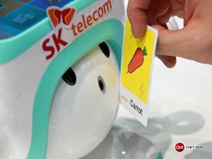 SK Telecom's learning robot Atti reads a card